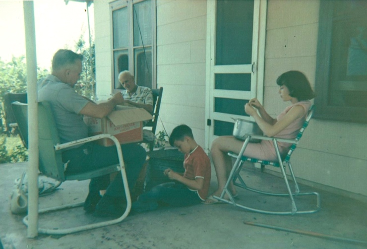 That's me sitting on the concrete porch shelling black-eyed peas, along with Grandpa, my father and my sister.