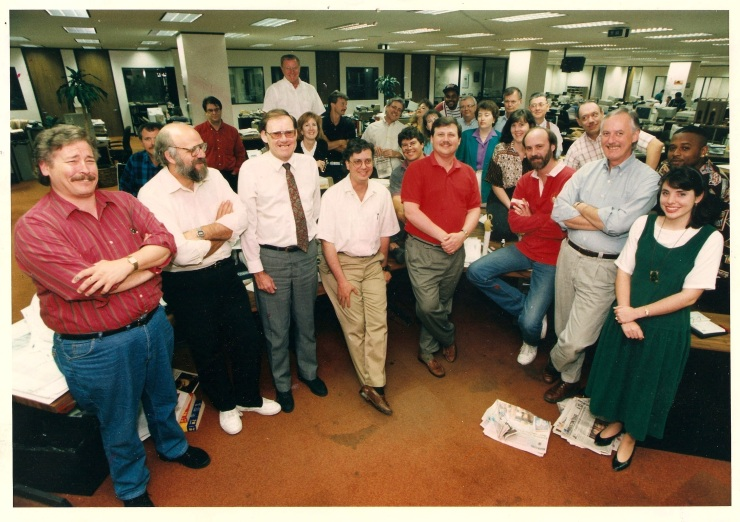 I don't remember the occasion, but here's a big group of some of the best people I ever worked with, standing around the Universal Desk in The Houston Post newsroom. That's me in the tan slacks, and standing next to me -- the only guy professional enough to be wearing a tie -- is the Bertmeister, Bert Walter.