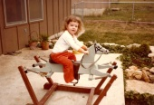 My daughter, Rebekah, on my old rocking horse.