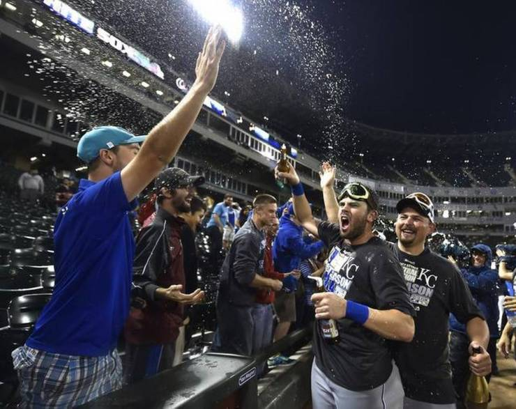 In this Kansas City Star photo, Royals players celebrate with their fans who traveled to Chicago to watch them clinch a playoff spot.