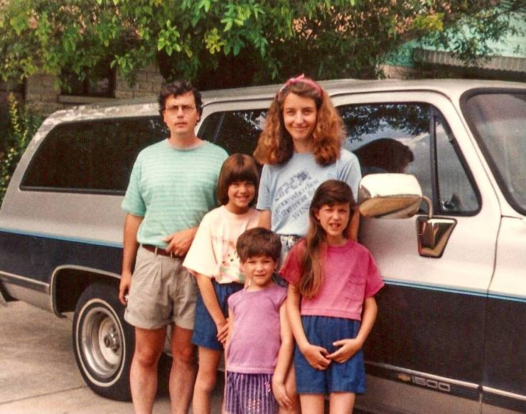 My family with the silver and blue Suburban in the driveway of my parents' home in San Antonio. Did we leave the next morning on a trip along U.S. Highway 90 West? Honestly, I don't recall, but it's a good possibility.