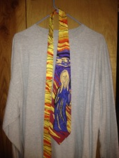For an evening on the town, my nicest tie adds a splash of color to the same understated gray t-shirt.