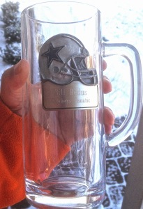 """One of my daughters had this mug specially made for my father. Naturally, it has passed to me, and only comes out on game day. Under his name, the inscription reads, """"Cowboys Fanatic."""""""