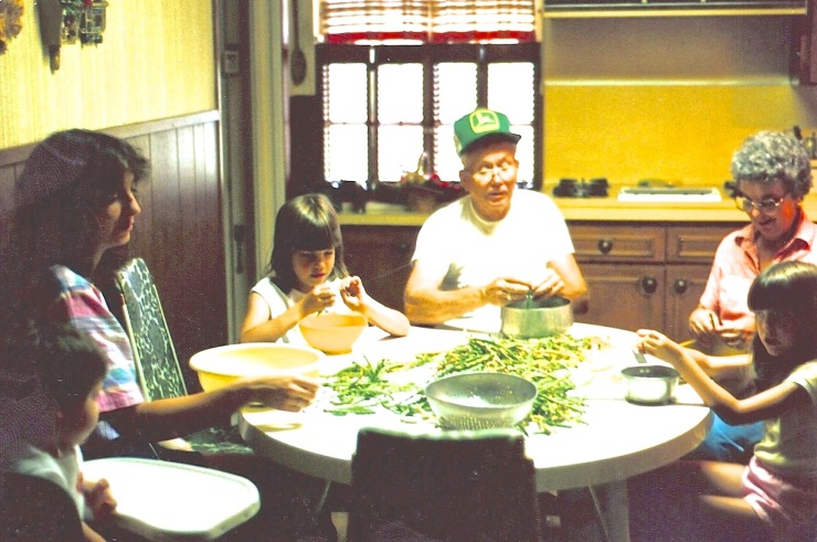 That's my mother on the right, shelling black-eyed peas at her kitchen table, along with my father, my wife and three kids when they were small.