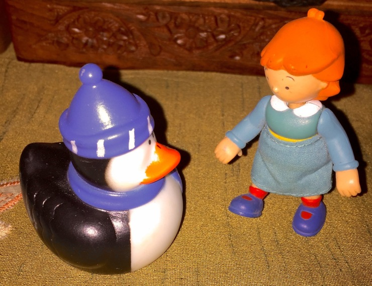 Back home, the damsel gets to know my penguin, rescued during a previous search. One of these days I'll put them into another cache for someone else to find.