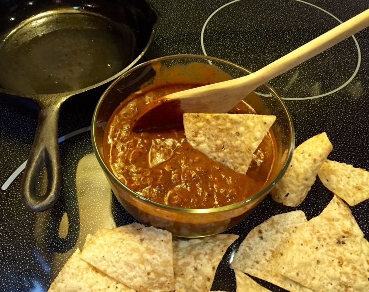 Completed Jingle Bell Salsa with an artful arrangement of tortilla chips on the stovetop.