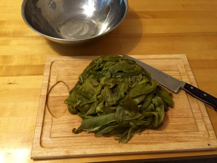 A mound of roasted, peeled and seeded green chile, ready for chopping.