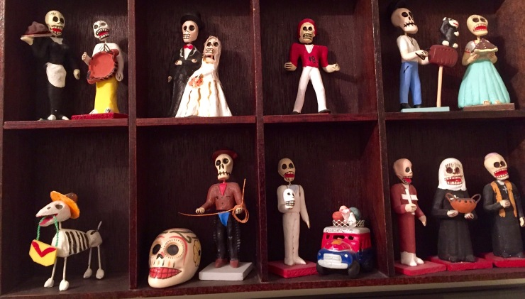 Detail of the Dia de los Muertos figures above our family shrine. The delicate figures were painstakingly collected over many years of trips to Mexico and South Texas, and I'm always looking for more to add to the collection.