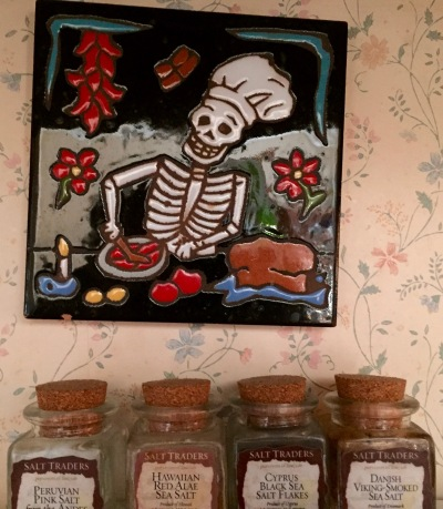 A bony chef whips up something delicious over our kitchen range. Anyone who has eaten my cooking can attest to the appropriateness of the decoration!