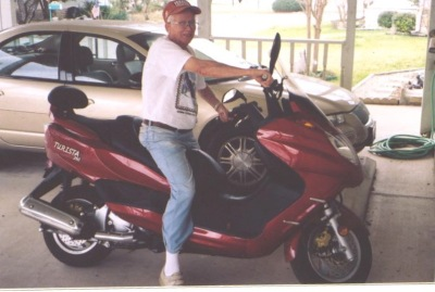 Under the carport, Daddy borrowed a friend's scooter to take this picture of himself, telling my sister and I that he'd bought it to ride to his chemotherapy appointments. It wasn't funny then, but it is now.