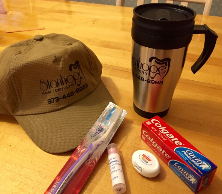 In addition to the usual toothbrush, toothpaste, floss and lip balm, I also got a Stanhope Family Dentistry cap and travel mug!