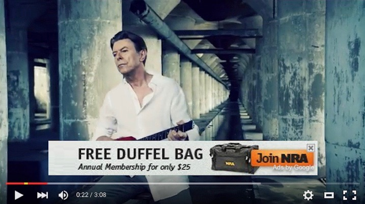 David Bowie decries gun violence with an NRA ad superimposed on the video.