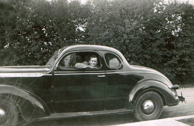 I don't know much about this photo, but that's Daddy, done with hitchhiking and finally behind the wheel.