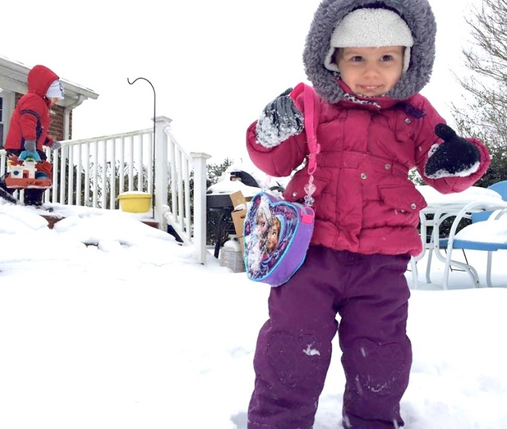 Never venture out in a snowstorm without your color-coordinated purse! That's my granddaughter!
