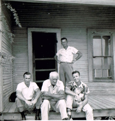 In a scene reminiscent of The Grapes of Wrath, my father, background, with Grandpa and two of my uncles.