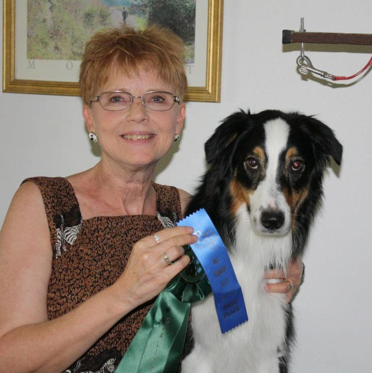 My sister, Susan, has gone to the dogs, literally. Self-described as a retired dog-wrangler, here she is with one of her prize-winning Aussies, Poe.