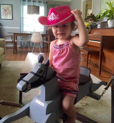 Granddaughter Lillian rides the horse made by her great-great-grandfather. Read about Lillian Hazel under H in the A-Z Challenge.