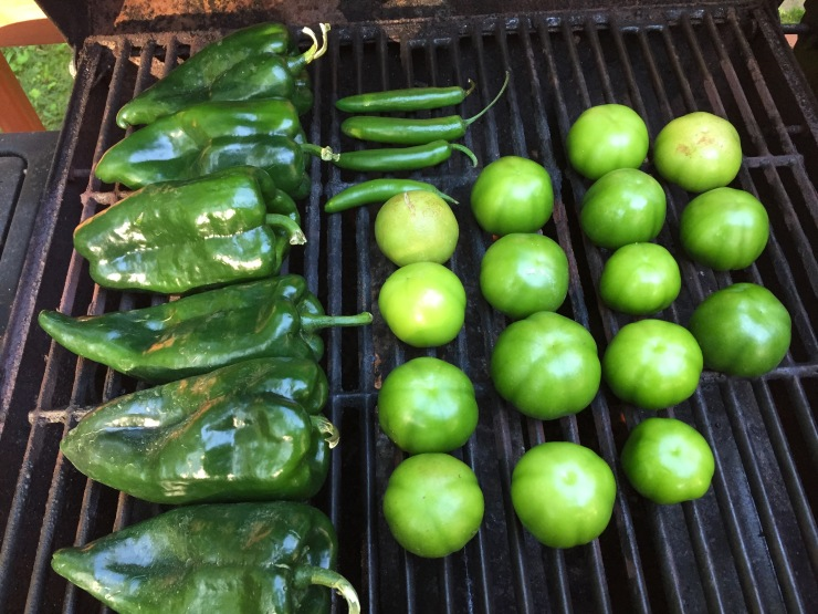 Fresh poblano peppers, serrano chiles and tomatillos populate the grill on an early morning in New Jersey.