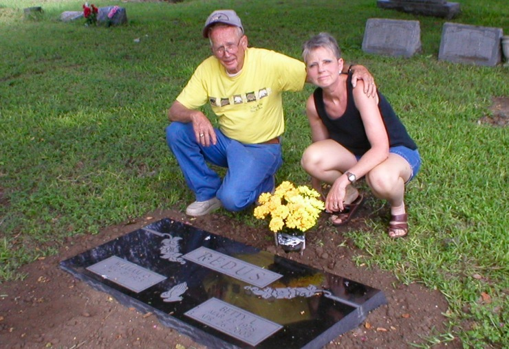 My father and sister at my mother's grave after the placement of her headstone. Daddy now rests beside her.