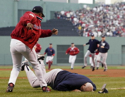 Pedro Martinez throws cute old man Don Zimmer to the turf during a brawl at Fenway Park.